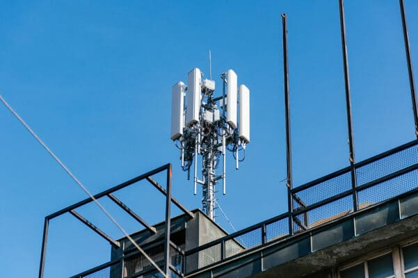 5G Network Tower in City on Building